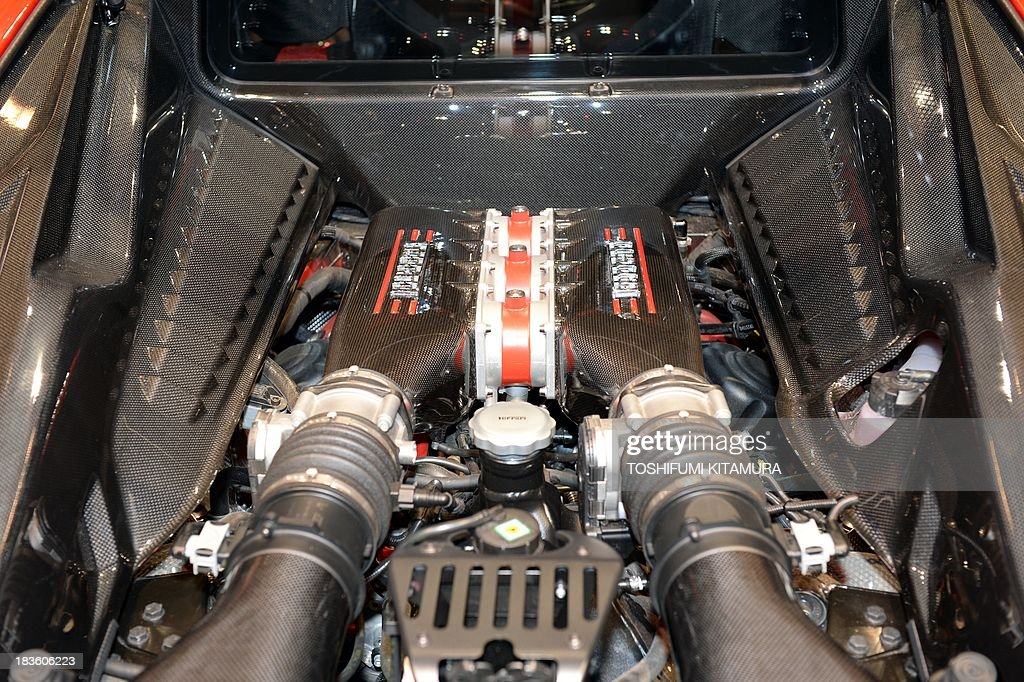 This picture shows the engine room of Ferrari 458 Speciale, a new special edition of Ferrari 458 Italia, during a press preview in Tokyo on October 8, 2013. Introduced at the Frankfurt motor show in September 2013, the 458 Speciale will deliver in Japan with a price of 32.9 million yen (about 339,199 USD).