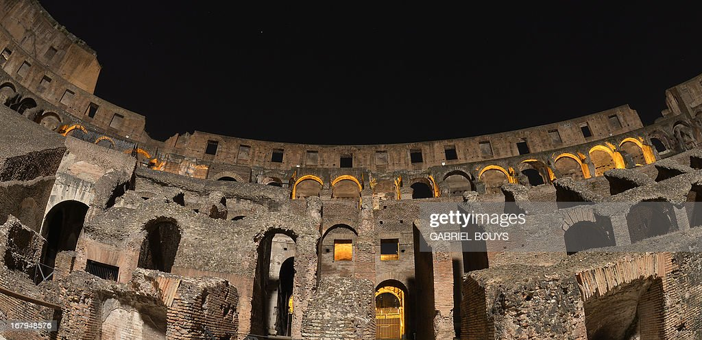 This picture shows the inside of the Colosseum during a preview of the night tour 'The moon over the colosseum' late on May 2, 2013 in Rome. 'The moon over the colosseum', a guided tour at night of the Flavian Amphitheatre will take place from May 5 to October 6, 2013 every Thursdays and Saturdays.