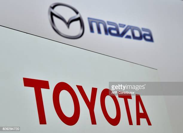 This picture shows the logo of Japan auto giants Toyota Motor Corporation and Mazda Motor Corporation in Tokyo on August 4 2017 Japanese auto giant...