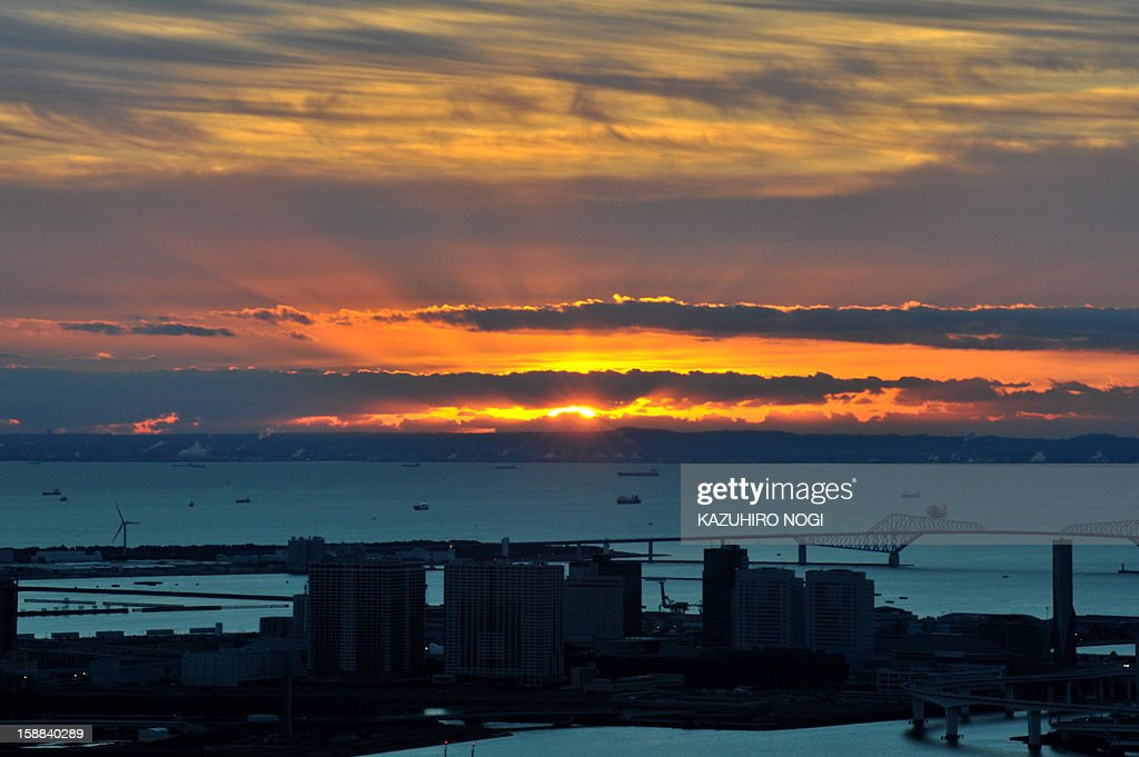 This picture shows the sunrise behind a cloud early on New Year's Day over Tokyo Bay on January 1, 2013. Asian capital cities brought in the New Year in spectacular style after Sydney set off a global wave of fireworks, with long-isolated Yangon joining the pyrotechnic partying for the first time.