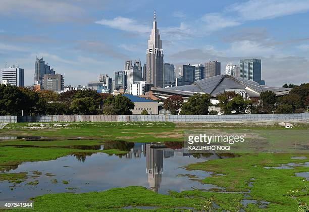 This picture shows the Tokyo's Shinjuku skyscrapers and the planned construction site for the new national stadium for the Tokyo 2020 Olympic Games...