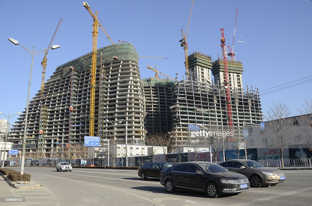 This picture shows the under-construction Wang Jing SOHO complex by renowned architect Zaha Hadid in Beijing on January 3, 2013. Already famed for fake designer bags and pirated DVDs, imitation in China may have reached new heights with a set of towers that strongly resemble ones designed by renowned architect Zaha Hadid. It could rank among the more flagrant ripoffs in a country already notorious for imitating foreign products without permission -- but the developer of the Chongqing project, Meiquan 22nd Century, has denied any copying.