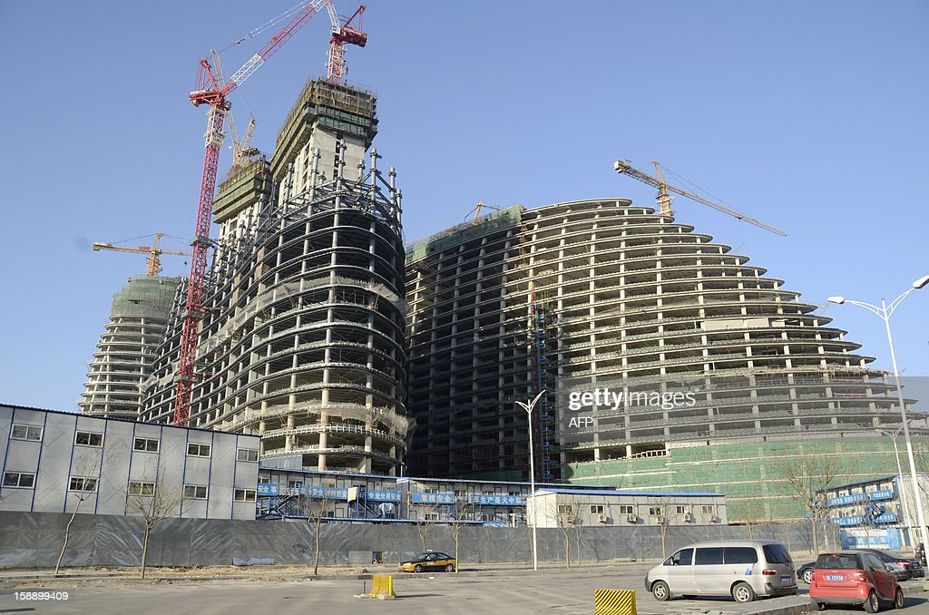 This picture shows the under-construction Wang Jing SOHO complex by renowned architect Zaha Hadid in Beijing on January 3, 2013. Already famed for fake designer bags and pirated DVDs, imitation in China may have reached new heights with a set of towers that strongly resemble ones designed by renowned architect Zaha Hadid. It could rank among the more flagrant ripoffs in a country already notorious for imitating foreign products without permission -- but the developer of the Chongqing project, Meiquan 22nd Century, has denied any copying. AFP PHOTO / WANG ZHAO