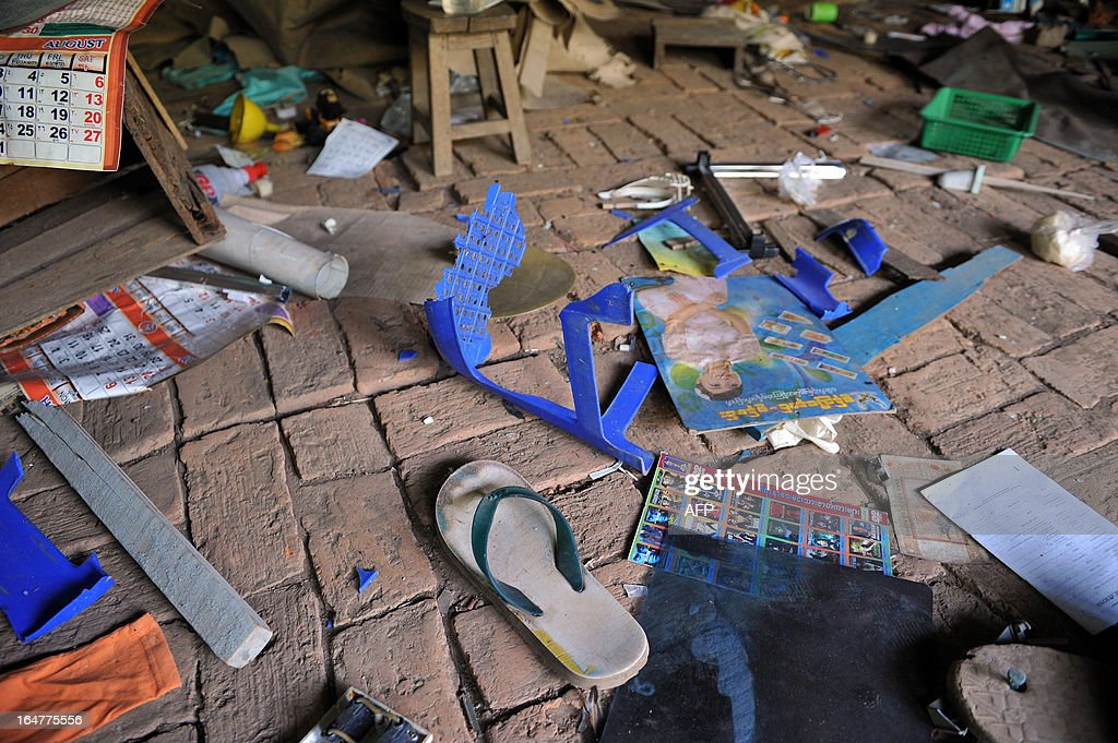 This picture shows various items lying on the floor of a destroyed mosque after sectarian violence spread through central Myanmar, in Okpho, Bago division on March 28, 2013. Myanmar's Muslim leaders have appealed to President Thein Sein to take swift action to quell religious violence, accusing security forces of standing by as rioters went on a rampage. AFP PHOTO/Ye Aung THU