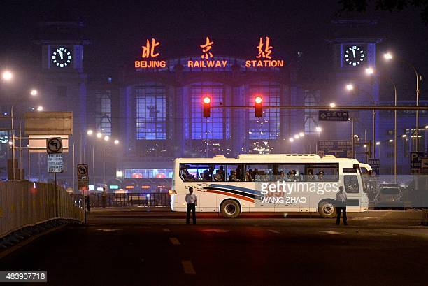 This picture take on August 13 2015 shows a bus carrying soldiers as it drives by Chang'an street during the rehearsal of a military parade for the...