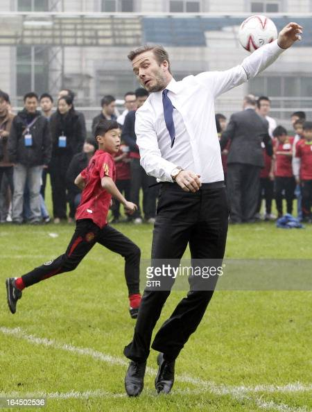 This picture take on March 23 2013 shows football superstar David Beckham during a game with young players in a stadium in Wuhan central China's...