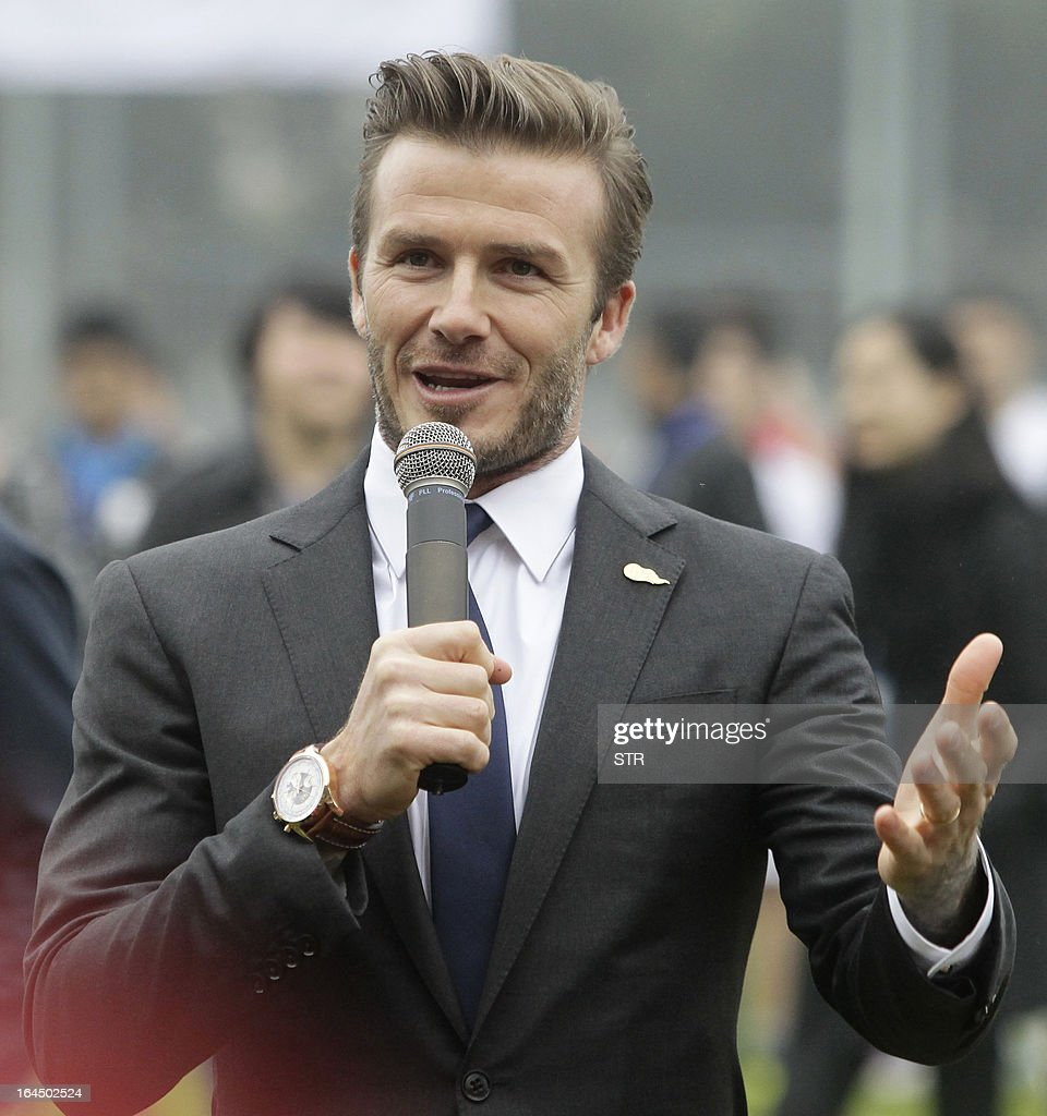 This picture take on March 23, 2013 shows football superstar David Beckham speaking during a meeting with young players and fans in a stadium in Wuhan, central China's Wuhan province. Beckham raised the prospect of one last stop on his global football journey on March 20, refusing to rule out playing in China after his contract with Paris Saint-Germain ends. CHINA