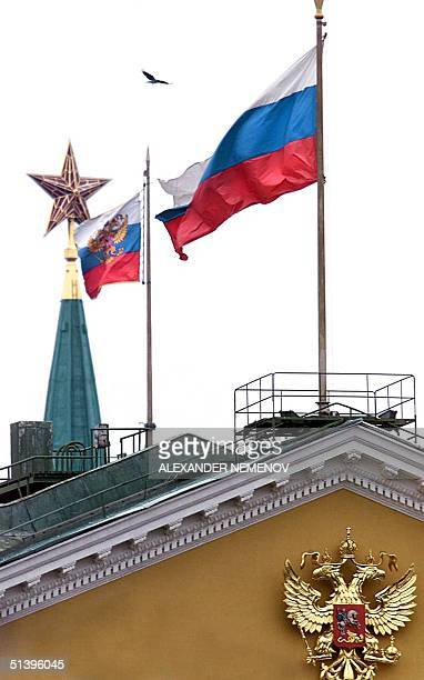 This picture taken 06 December 2000 shows the Russian State Flag and the Standard of the President of Russian Federation fluttering over the Kremlin...