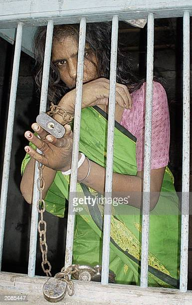 This picture taken 06 June 2003 shows Lakshmi Ghosh a 35year old Indian woman chained in her family home in the village of Malda some 360 kms north...