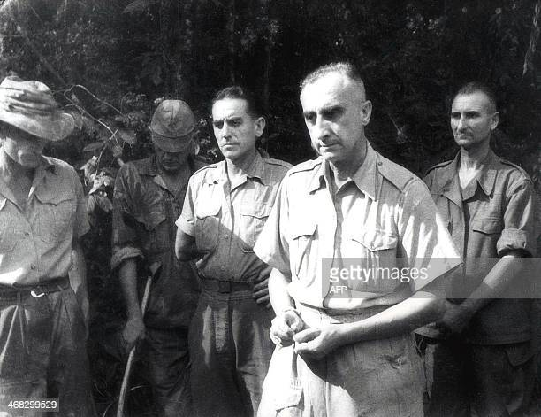 This picture taken 07 May 1954 shows French Chief Commander of Dien Bien Phu garrison Colonel Christian de la Croix de Castries and his unidentified...