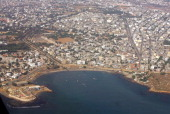 This picture taken 23 October 2007 shows an aerial view of a construction site of the Corniche road in Dakar near the Soumbedioune beach The...
