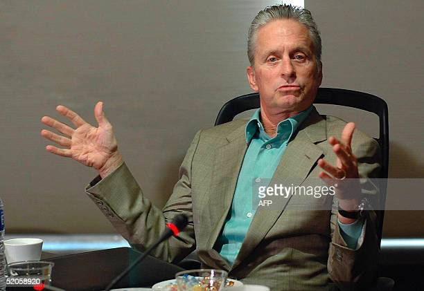 This picture taken 24 January 2005 shows US Oscarwinning actor Michael Douglas gesturing while announcing his next adventure flick 'Racing the...