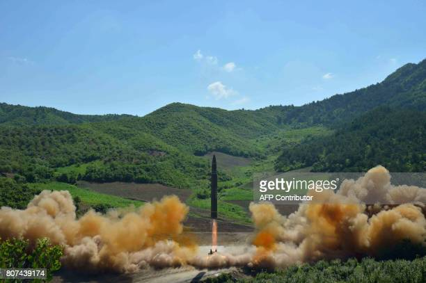 This picture taken and released on July 4 2017 by North Korea's official Korean Central News Agency shows the testfire of the intercontinental...