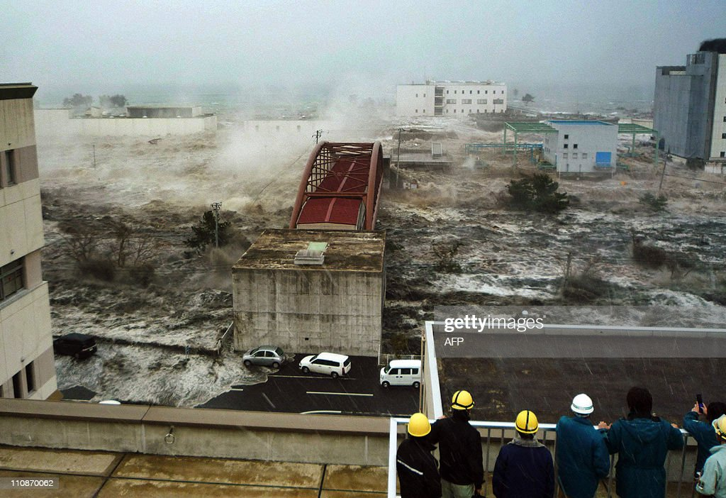 This picture taken by Sendai city official Hiroshi Kawahara on March 11 2011 and released through Jiji Press on March 25 2011 shows muddy tsunami...