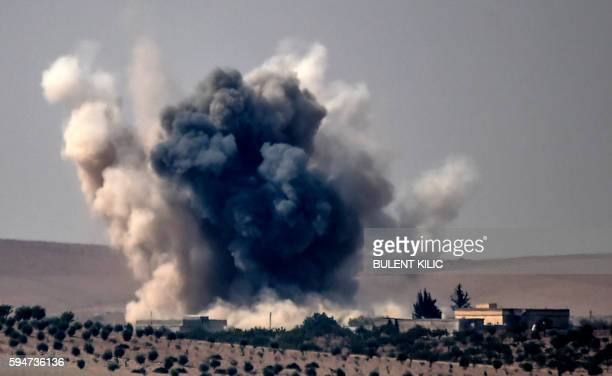 TOPSHOT This picture taken from the Turkish Syrian border city of Karkamis in the southern region of Gaziantep on August 24 2016 shows smoke billows...