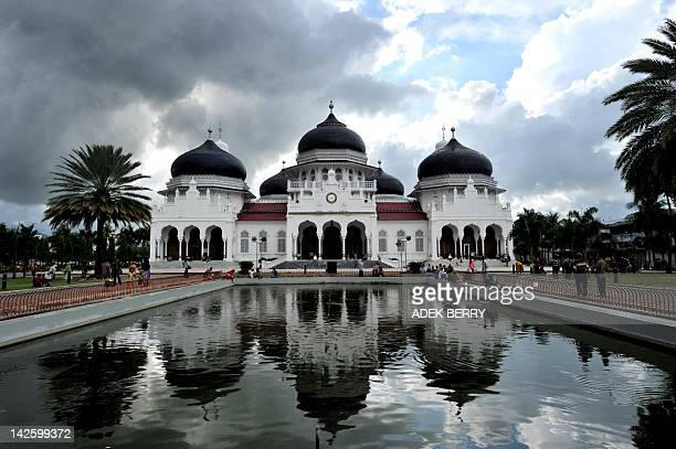 This picture taken in Banda Aceh on April 8 2012 shows the Baiturrahman great mosque in Banda Aceh Whenever the morals police in Indonesia's only...