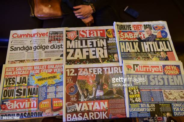CORRECTION This picture taken in Istanbul on April 17 shows the front pages of Turkish newspapers bearing headlines concerning referendum Cumhuriyet...