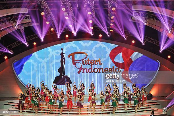 This picture taken in Jakarta on January 29 2014 shows Indonesian finalists of Miss Indonesia 2014 performing on stage during the grand final...