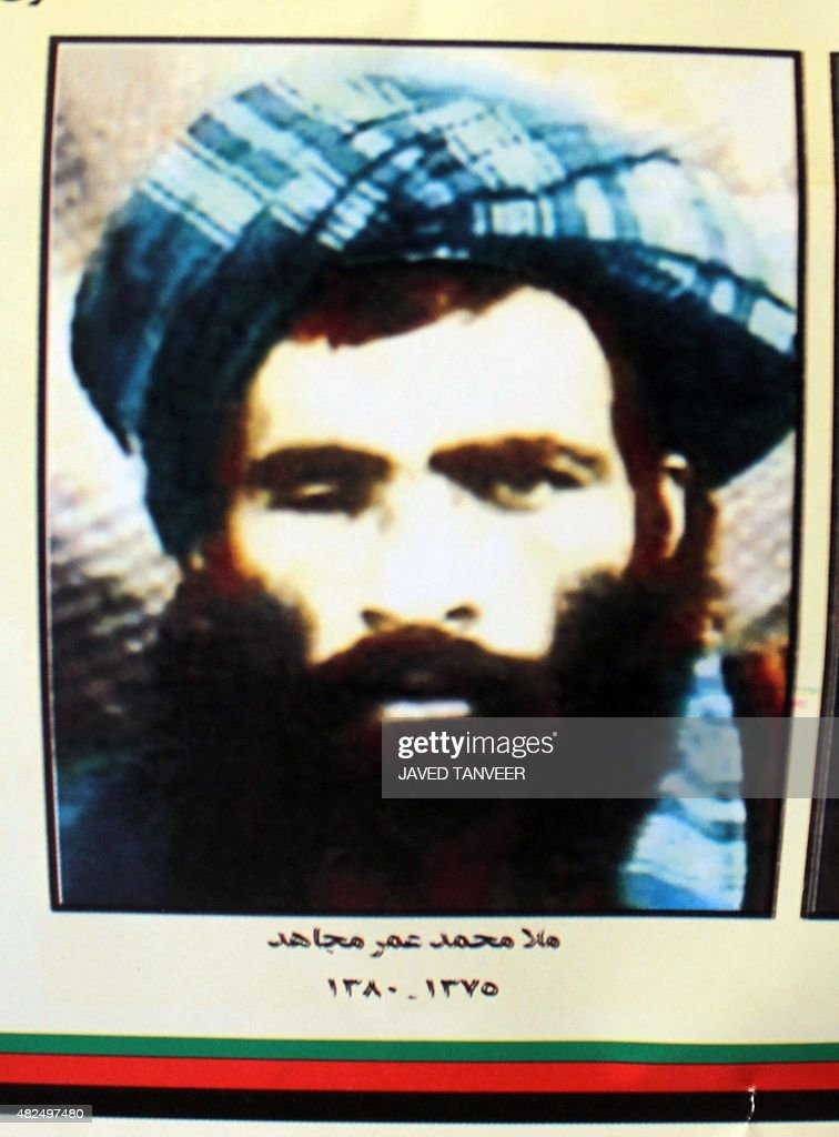 This picture taken in Kandahar on July 31 2015 shows a calender bearing the image of the Afghan Taliban's deceased leader Mullah Omar The Taliban...