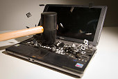 This picture taken in London on May 9 2013 is a posed image of a laptop computer's keyboard shattering into pieces after an impact AFP PHOTO/Leon Neal