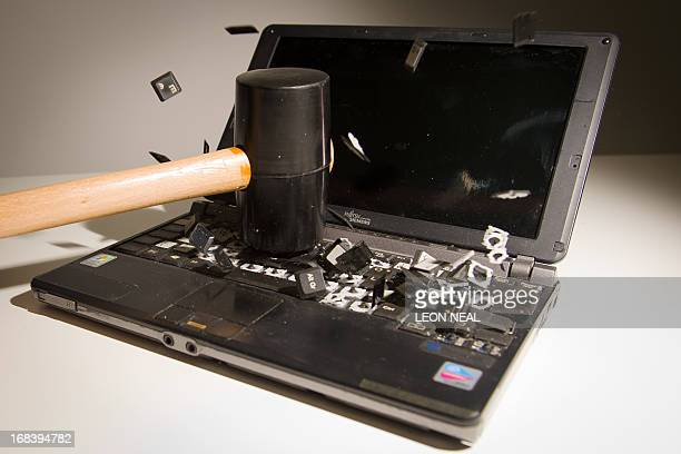 This picture taken in London on May 9 2013 is a posed image of a laptop computer's keyboard shattering into pieces after an impact AFP PHOTO/Leon...