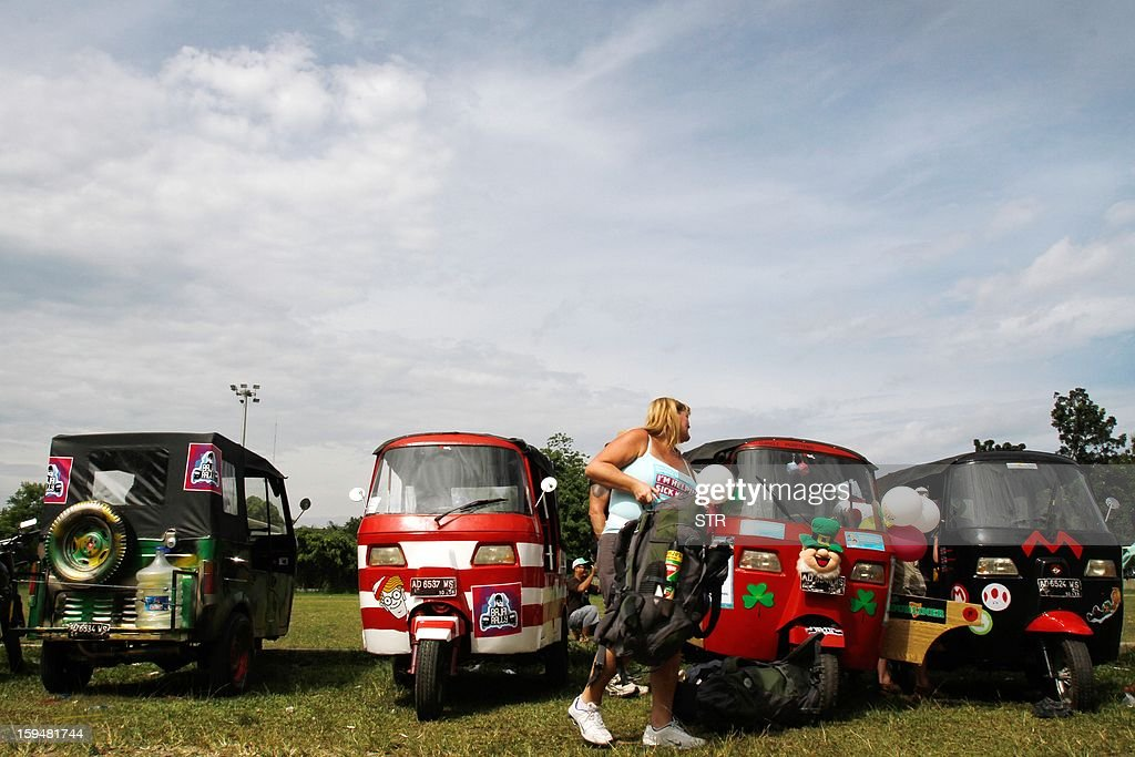 This picture taken in Medan on January 13, 2012 shows a participant of a rally, named the 'Bajai rally' after the Indian auto rickshaw brand Bajaj, aiming to raise funds and awareness to promote forest conservation, with the participants hoping to make it to the resort island of Bali by January 26. Dozens of tourists set off through Indonesia's malaria-infested jungles and potholed roads on three-wheelers as part of a rally to raise funds for forest conservation, organisers said on January 14. AFP PHOTO