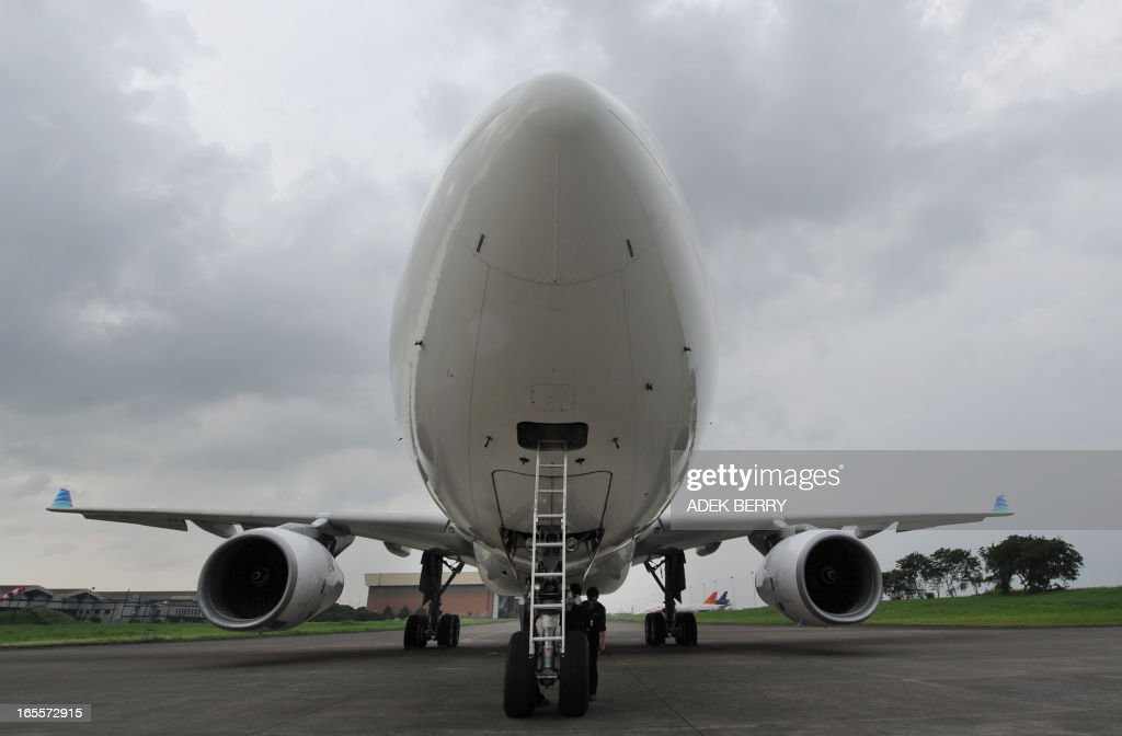 This picture taken in Tangerang on April 4, 2013 shows a Garuda Indonesia Airbus 330-200 plane during maintenance at the Sukarno-Hatta airport in Tangerang. A new rivalry between the worlds's biggest planemakers is heating up in Indonesia after a record deal for Airbus in a market with huge potential that until now has been a 'fortress' for Boeing. Indonesians are increasingly relying on air travel to link the archipelago of 17,000-odd islands, with up to 900 new planes set to be delivered to Indonesia in the next decade, according to the government. The potential is massive -- only six percent of Indonesians have travelled by air, according to officials, in a nation of 240 million people that has consistently clocked annual economic growth above six percent.