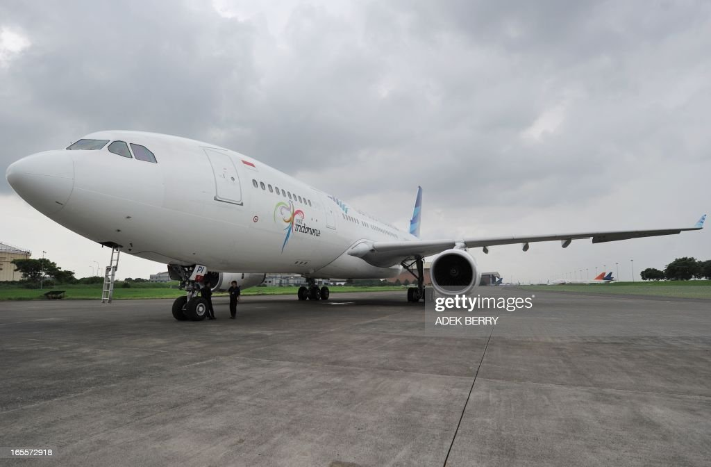 This picture taken in Tangerang on April 4, 2013 shows a Garuda Indonesia Airbus 330-200 plane during maintenance at the Sukarno-Hatta airport in Tangerang. A new rivalry between the world's biggest planemakers is heating up in Indonesia after a record deal for Airbus in a market with huge potential that until now has been a 'fortress' for Boeing. Indonesians are increasingly relying on air travel to link the archipelago of 17,000-odd islands, with up to 900 new planes set to be delivered to Indonesia in the next decade, according to the government. The potential is massive -- only six percent of Indonesians have travelled by air, according to officials, in a nation of 240 million people that has consistently clocked annual economic growth above six percent.