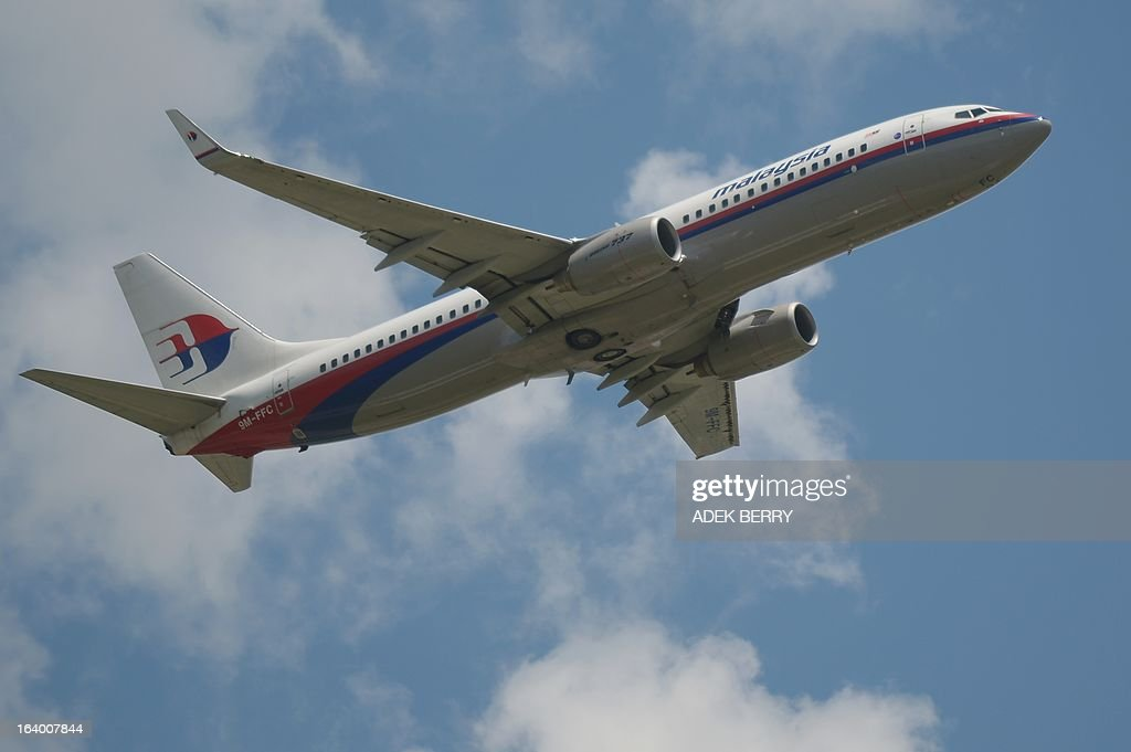 This picture taken in Tangerang on March 18 2013 shows a Malaysia Airlines Boeing 737 plane flying over the SukarnoHatta airport in Tangerang...