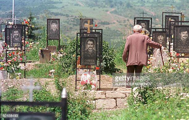 This picture taken June 1994 in Stepanakert the capital of Nagorny Karabakh shows an Armenian man visiting the grave of his son at the memorial...