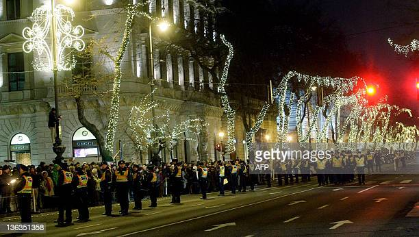 This picture taken late on January 2 2012 shows Hungarian police standing surrounded at the State Opera House of Budapest by tens of thousands of...