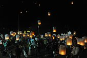 This picture taken late on November 6 2014 shows Thai people releasing lanterns as part of celebrations of the Loi Krathong festival in the southern...
