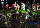 This picture taken late on November 6 2014 shows Thai people releasing decorated 'krathongs' in water as part of celebrations of the Loi Krathong...