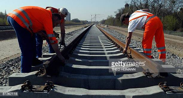 FILES This picture taken on 15 April 2004 shows employees of German railway company Deutsche Bahn working on a railroad embankment in Berlin As a...