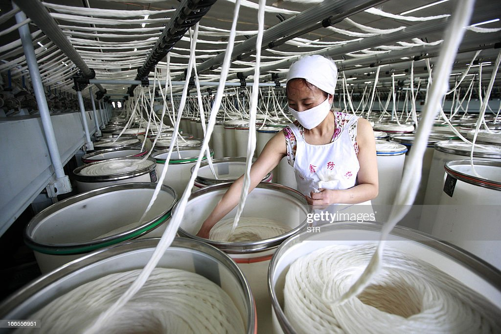 This picture taken on April 10, 2013 shows a laborer working in a textile factory in Huaibei, central China's Anhui province. China's economic growth likely picked up slightly in the first quarter of this year, according to an AFP poll of analysts, but they say the rebound is fragile and key data unreliable. CHINA