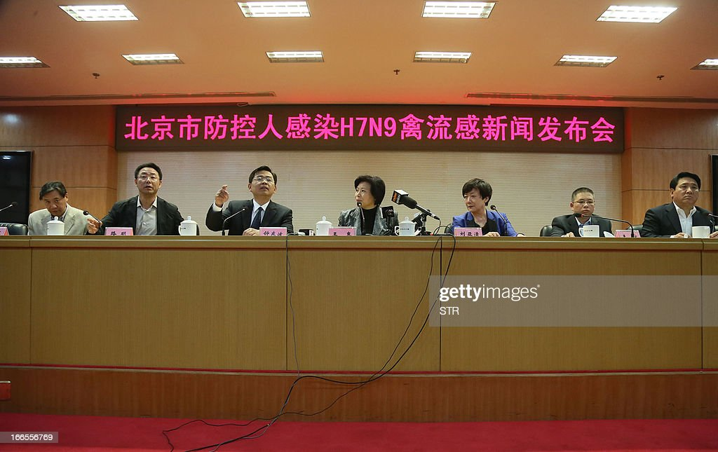 This picture taken on April 13, 2013 shows Beijing officials explaining the current conditions after Beijing reports its first human case of H7N9 bird flu at a press conference in Beijing. China's H7N9 bird flu virus spread to a new province on April 14, with state media reporting two human cases in central Henan just west of the area where the disease has been centred. Until April 13, when one case was reported in the capital of Beijing, all other instances had occurred in the eastern city of Shanghai and nearby Zhejiang, Jiangsu and Anhui provinces hundreds of miles (kilometres) away. CHINA