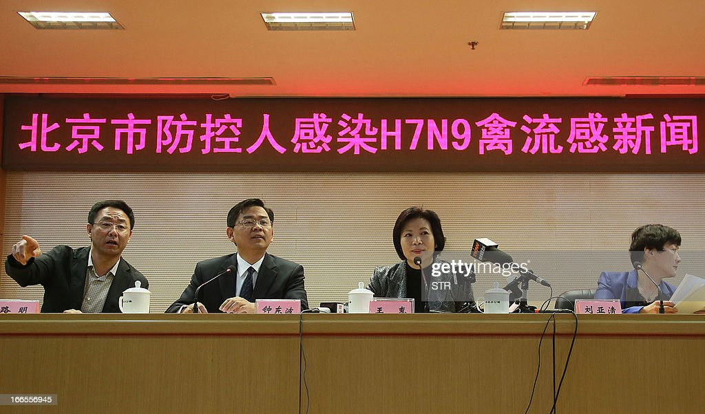 This picture taken on April 13, 2013 shows Beijing officials explaining the current conditions after Beijing reports its first human case of H7N9 bird flu at a press conference in Beijing. China's H7N9 bird flu virus spread to a new province on April 14, with state media reporting two human cases in central Henan just west of the area where the disease has been centred. Until April 13, when one case was reported in the capital of Beijing, all other instances had occurred in the eastern city of Shanghai and nearby Zhejiang, Jiangsu and Anhui provinces hundreds of miles (kilometres) away. CHINA OUT AFP PHOTO