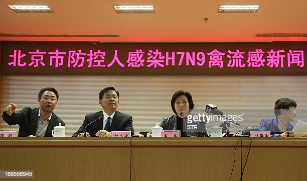 This picture taken on April 13 2013 shows Beijing officials explaining the current conditions after Beijing reports its first human case of H7N9 bird...