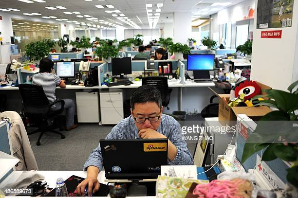 This picture taken on April 16 2014 shows a man using a laptop at an office of Sina Weibo widely known as China's version of Twitter in Beijing China...