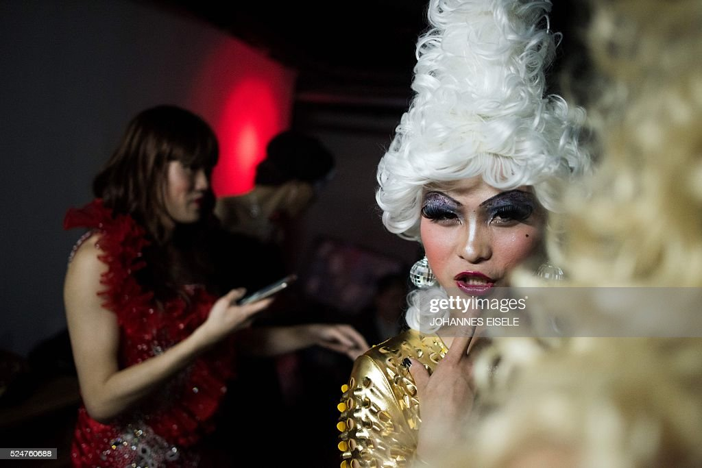 This picture taken on April 18, 2016, shows Yu Xiaoyang - who uses the stage name Xiao Bai meaning 'Little White' - posing backstage during a preliminary round of Big Queen, a cross-dressing contest in the Icon Club in Shanghai. In a bouffant blonde wig and outsize eyelashes, Yu Xiaoyang flamboyantly parades across a Shanghai stage, his fake breasts filling his skintight golden jumpsuit. Yu was among 20 contestants taking part in a cross-dressing competition in China's commercial hub. the contry only decriminalised homosexuality in 1997 and discrimination is common, although tolerance is greater in major cities, and the Shanghai Pride group mounts an annual series of events for the lesbian, gay, bisexual and transgender (LGBT) community and their supporters. / AFP / JOHANNES