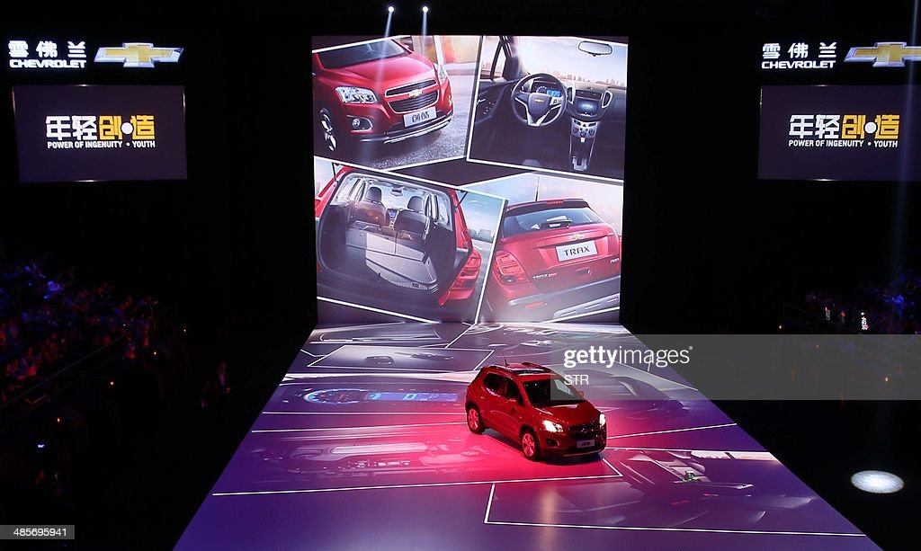 This picture taken on April 19, 2014 shows a new Chevrolet Trax car on display during the 'Chevrolet Gala Night' for General Motors (GM), ahead of the 'Auto China 2014' Beijing International Automotive Exhibition in Beijing. Leading automakers are gathering in Beijing for the kickoff of China's biggest car show, but lackluster growth and environmental restrictions in the world's largest car market have thrown uncertainty into the mix. More than 1,100 vehicles are being showcased at the auto show, which opens to the public on April 21. CHINA