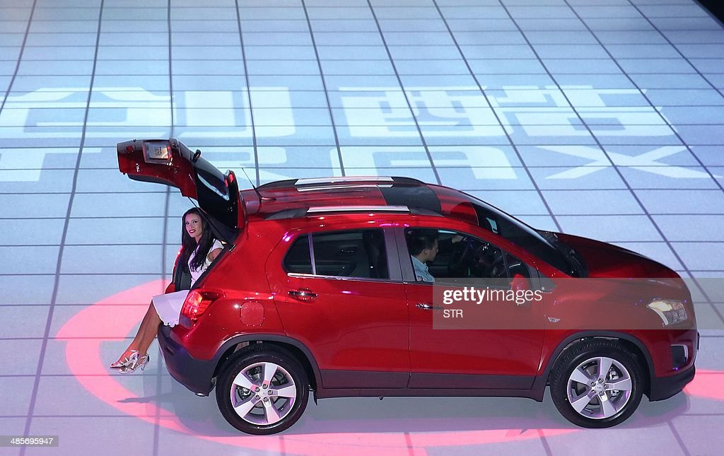 This picture taken on April 19, 2014 shows a new Chevrolet Trax car on display during the 'Chevrolet Gala Night' for General Motors (GM), ahead of the 'Auto China 2014' Beijing International Automotive Exhibition in Beijing. Leading automakers are gathering in Beijing for the kickoff of China's biggest car show, but lackluster growth and environmental restrictions in the world's largest car market have thrown uncertainty into the mix. More than 1,100 vehicles are being showcased at the auto show, which opens to the public on April 21. CHINA OUT AFP PHOTO