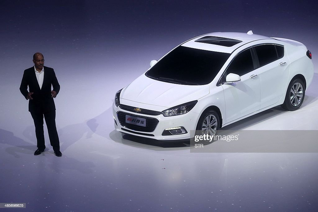 This picture taken on April 19, 2014 shows a new-generation Chevrolet Cruze making its debut show at the 'Chevrolet Gala Night' of the General Motors (GM), ahead of the 'Auto China 2014' Beijing International Automotive Exhibition in Beijing. Leading automakers are gathering in Beijing for the kickoff of China's biggest car show, but lackluster growth and environmental restrictions in the world's largest car market have thrown uncertainty into the mix. More than 1,100 vehicles are being showcased at the auto show, which opens to the public on April 21. CHINA