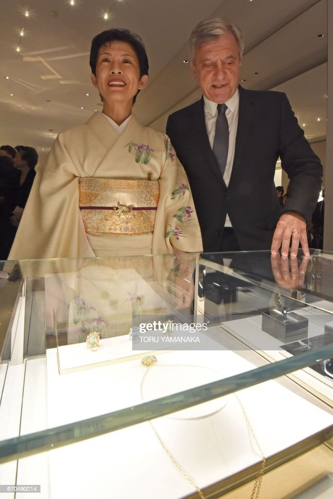 This picture taken on April 19, 2017 shows Sidney Toledano (R), president and chief executive officer of Christian Dior Couture, guiding Japan's Princess Takamado during a preview of Dior's new shop at the Ginza shopping district in Tokyo. / AFP PHOTO / Toru YAMANAKA / TO GO WITH AFP STORY by Anne BEADE
