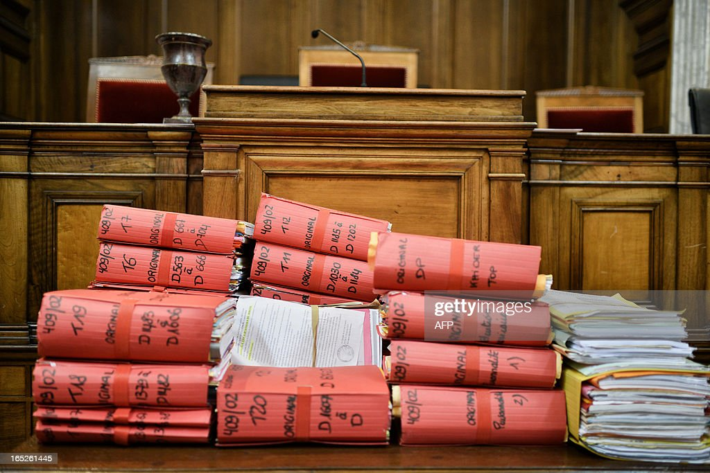 This picture taken on April 2, 2013 shows folders in the courtroom of Lyon's criminal court, on the opening day of Christophe Khider and Omar Top El Hadj's trial. They are judged for having escaped from jail using explosives and taking hostages two prison staffs.