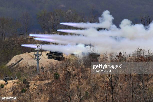TOPSHOT This picture taken on April 21 2017 shows South Korean K136 Kooryong 130mm 36round multiple rocket launch system firing rockets during a...