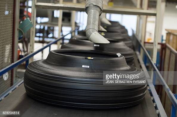 This picture taken on April 22 2016 shows tyres during manufacturing at the Michelin truck tyres factory of La rochesurYon western France The plant...