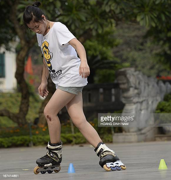 This picture taken on April 24 2013 shows a inline skater at a public park in downtown Hanoi AFP PHOTO/HOANG DINH Nam