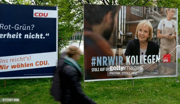 This picture taken on April 24 2017 in Duesseldorf shows an electoral poster featuring NorthRhine Westfalia´s prime minister Hannelore Kraft of...