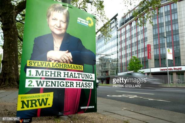 This picture taken on April 24 2017 in Duesseldorf shows an electoral poster featuring NorthRhine Westfalia´s Green party candidate Sylvia Loehrmann...
